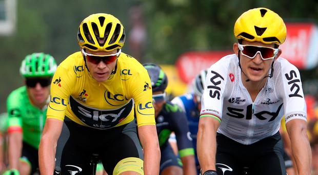 Chris Froome, riding for Team Sky, in the leader's jersey crosses the finish line during stage 10 of the Tour de France yesterday. Photo: Chris Graythen/Getty Images