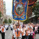 Orangemen and bandsmen in Belfast city centre on the Twelfth