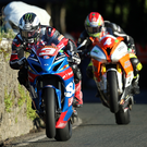 Full on: Michael Dunlop leads Dan Kneen during yesterday's opening races at the Southern 100