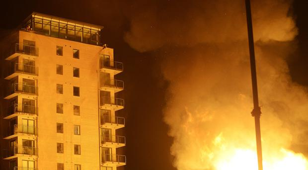 Fire crews battle to protect a 10 storey apartment block as flames from an Eleventh bonfire encroach in Wellwood Street on Tuesday night. [Photo: Arthur Allison, Pacemaker]