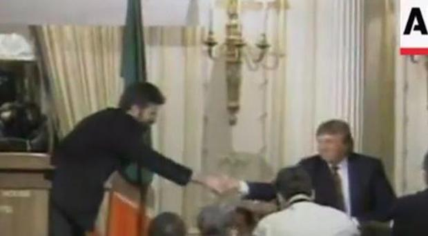 Screen grab from the AP footage of Donald Trump meeting Gerry Adams.