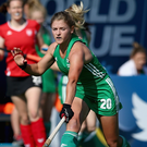 Race on: Chloe Watkins battles for Ireland yesterday. Photo: Jan Kruger/Getty Images