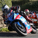 Tight line: Michael Dunlop leads Dan Kneen around Ballabeg on his way to victory in the Senior race at the Southern 100 on the Isle of Man last night. Photo: Stephen Davison
