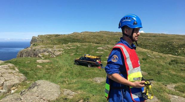 Teams from across Northern Ireland and Scotland came together to rescue a woman following a serious accident at Fair Head on the north Antrim coast.