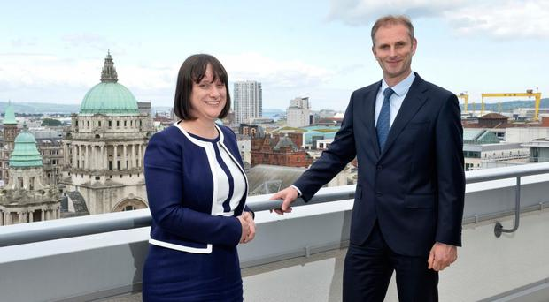New EY Belfast partner Ruth Logan with Michael Hall from the firm