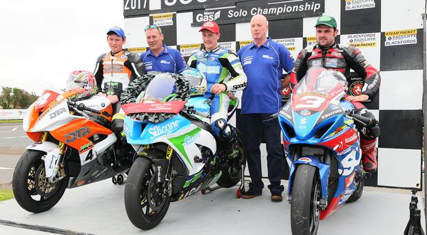 Winning line-up: Solo Championship winner Dean Harrison (centre) is flanked by runner-up Dan Kneen and third placed Michael Dunlop on the podium at the Southern 100 on the Isle of Man. Photo: Stephen Davison