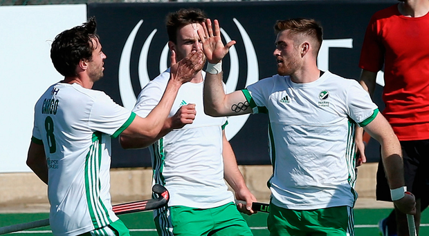 Goal heroes: Ireland's marksmen Chris Cargo (left) and Shane O'Donoghue (No.16) celebrate the last-gasp win against Egypt. Photo:Jan Kruger/Getty Images
