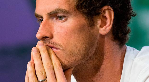 Big call: injured Andy Murray is pondering his next move. Photo: /Getty Images