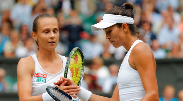 At a canter: Garbine Muguruza (right) after hammering Magdalena Rybarikova. Photo: Getty Images