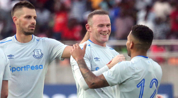 Man of the moment: Wayne Rooney is hailed by his new Everton team-mates after opening the scoring in a pre-season friendly. (AP Photo/Khalfan Said)