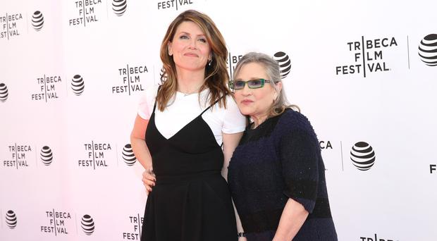 Sharon Horgan and Carrie Fisher (Photo by Robin Marchant/Getty Images for Tribeca Film Festival)