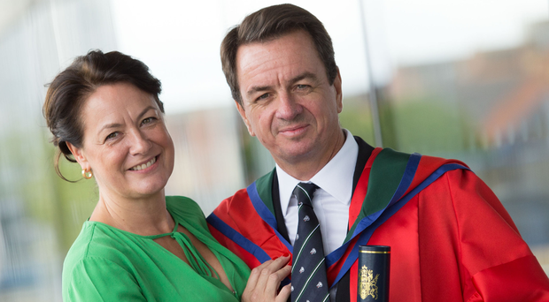 PROUD DAY: John Irvine receives the honorary degree of Doctor of Letters with his wife Libby at the Ulster University. Photo: Nigel McDowell/Ulster University