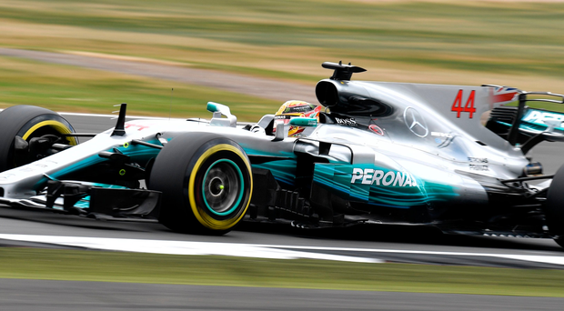 In the hunt: Lewis Hamilton during first practice at Silverstone yesterday. Photo: Getty Images