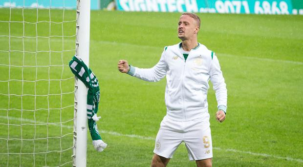 Celtic striker Leigh Griffiths cheers in the direction of the Celtic fans after tying a Celtic scarf to the goal post following the UEFA Champions League first leg against Linfield.
