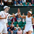 High five: Jamie Murray and Martina Hingis celebrate after reaching the mixed doubles final. Photo: Julian Finney/Getty Images