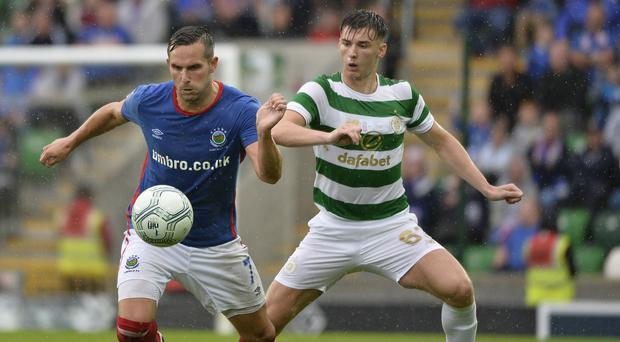 Ball watching: Andy Waterworth holds off Kieran Tierney at Windsor Park last night. Photo: Stephen Hamilton/Presseye