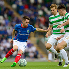 Linfield's Paul Smyth takes on Celtic's Kieran Tierney at Windsor Park during the UEFA Champions League clash.