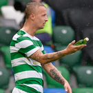 Trouble: Celtic's Leigh Griffiths picks up a bottle thrown from the crowd. Photo: Stephen Hamilton /Presseye