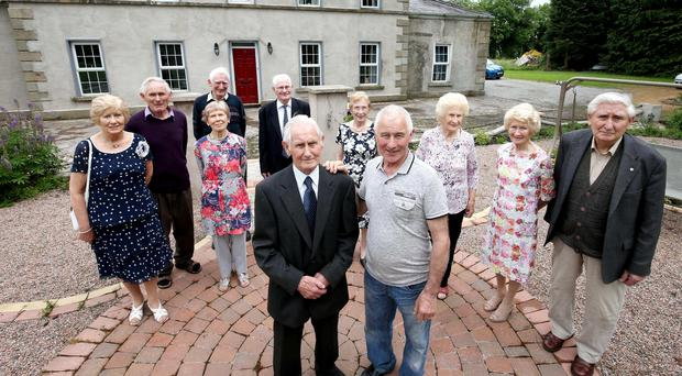 The Donnellys outside the family home
