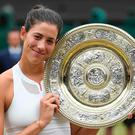 Spain's Garbine Muguruza poses with The Venus Rosewater Dish as she celebrates beating US player Venus Williams to win the women's singles final. Pic Glyn Kirk