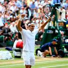 Roger Federer celebrates beating Marin Cilic in the Gentlemen's Singles Final