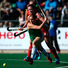 Taking aim: Kathryn Mullan scores against England