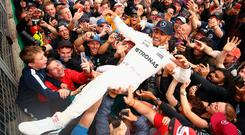 Silver surfer: Lewis Hamilton crowd surfs after British Grand Prix win at Silverstone