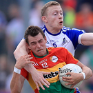 Action men: Monaghan's Colin Walshe tackles Sean Gannon