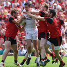 Big man: Tyrone's captain led by example as Red Hands claimed Ulster crown