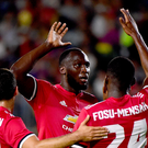 Romelu Lukaku celebrates a United goal with Timothy Fosu-Mensah and Henrikh Mkhitaryan