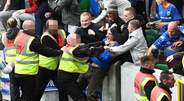 Linfield supporters come up against security.