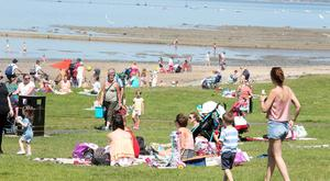 Press Eye Belfast - Northern Ireland 17th July 2017 People enjoy the sunny and warm weather at Seamark outside Holywood in Co. Down. Picture by Jonathan Porter/PressEye.com