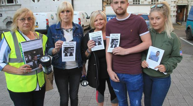 The Family of Dean McIlwaine at Belfast city hall help organise a search for Dean who has been missing from the 13th of July . Anne Taylor, Kim Malone (Aunt), and Cousins Jeanette Hunter, Jordan Malone, Lois Anderson. Picture Colm O'Reilly