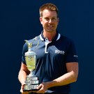 Goodbye: Henrik Stenson hands over the Claret Jug