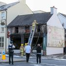 A fast food outlet and a first floor flat have sustained major damage in an overnight fire in Banbridge. This is the second fire at the premises in two weeks.