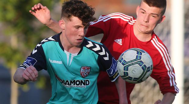 ©/Presseye.com - 17th July 2017. Press Eye Ltd - Northern Ireland - Hughes Insurance Foyle Cup 2017- U-17 - Derry City V Willowbank FC (Belfast) Derry's Edward O'Reilly and Williowbank's Ryan Paul Callaghan. Mandatory Credit Photo Lorcan Doherty / Presseye.com