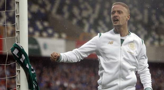 Trouble ahead: Leigh Griffiths after tying Celtic scarf to the Kop end goalpost at Windsor Park, for which he could be banned