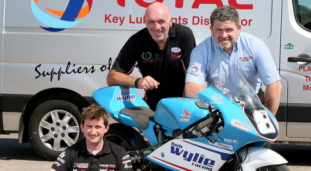 Total support: road racer Christian Elkin, MCE Ulster Grand Prix Clerk of the Course Noel Johnston and Plant Lubrication (NI) director Alan McCaffrey
