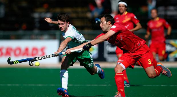 Sticking at it: Johnny McKee of Ireland and Sergi Enrique of Spain battle for possession in Johannesburg. Photo: Jan Kruger/Getty Images