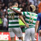 Celtic's scorers Tom Rogic and Scott Sinclair celebrate