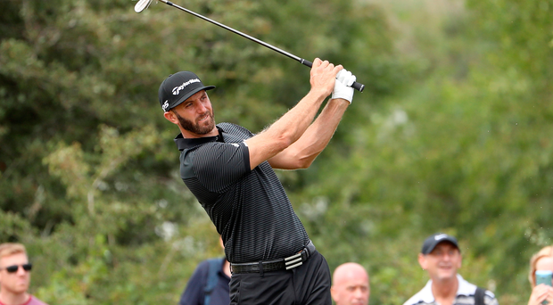 In the swing of it: Dustin Johnson during yesterday's practice round ahead of his bid for Open glory. Photo: Christian Petersen/Getty Images