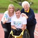 Spin class: Caroline Martin, Head of Marketing at Dale Farm, wheelchair racer Jack Agnew and Dame Mary Peters as Jack's £5,000 bursary award is announced. Photo: Marie Therese Hurson