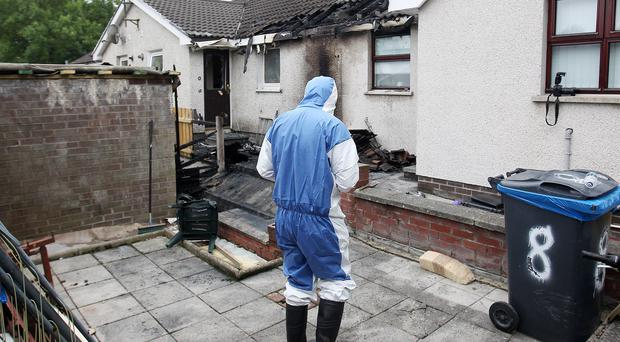 The scene at Glasvey Drive in Dunmurry where a man was rescued by neighbours from a fire