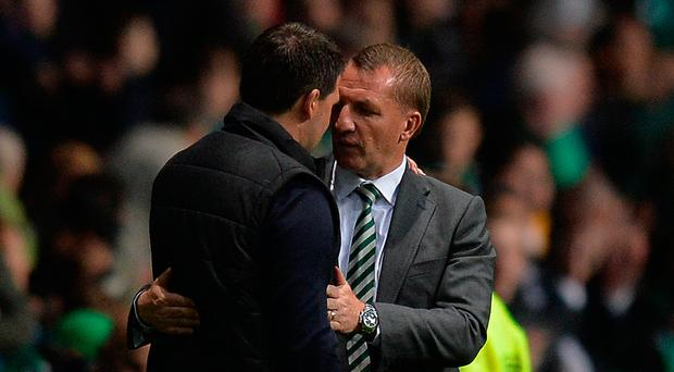 Celtic's Brendan Rodgers and Linfield boss David Healy embrace