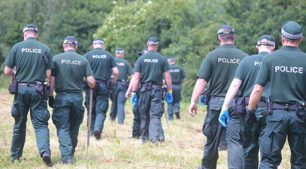 Press Eye Belfast - Northern Ireland 20th July 2017 The PSNI conduct an appeal and search for 22-year-old Dean McIlwaine who was last seen in the Carnmoney Road area of Newtownabbey on the 13th July. PSNI officers search a wooded area close to where Dean was last seen and the family home. Picture by Jonathan Porter/PressEye.com