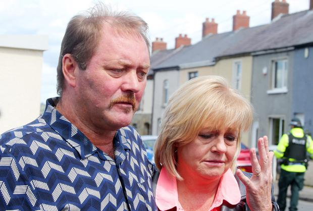 Dean's father Rodney and mother speak to the press on the Carnmoney Road.
