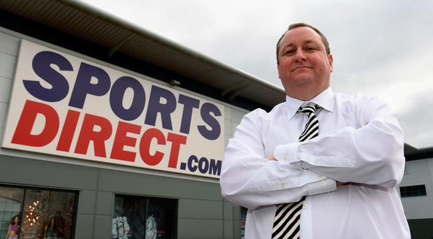 Sports Direct founder Mike Ashley has announced that the retailer has posted a 58.7% plunge in annual underlying pre-tax profits to £113.7 million. Photo: Joe Giddens/PA