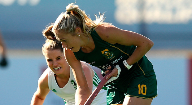 Not close enough: Shelley Jones of South Africa holds off Ireland's Emily Beatty. Photo: Jan Kruger/Getty Images