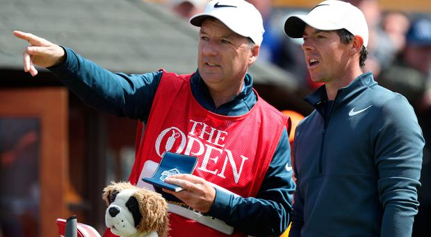 Northern Ireland's Rory Mc Ilroy speaks with his caddie before his round during day one of The Open Championship 2017 at Royal Birkdale Golf Club Southport. Andrew Matthews  PA Wire