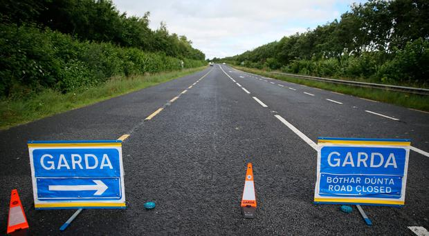 A Garda road closure close to the scene near Aclint Bridge in Ardee, Co Louth, after three women were killed and two men seriously injured in a road accident involving three cars. Pic: Brian Lawless/PA Wire